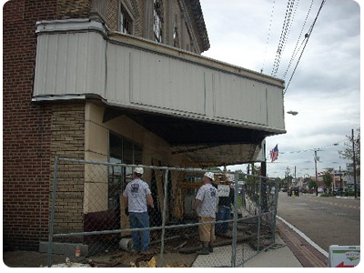 Construction crew removing damaged pieces